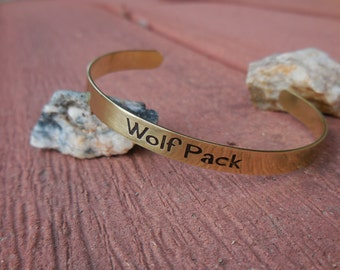 Brass Cuff etched with the words - Wolf Pack