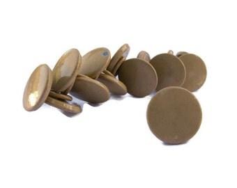 """14 tan metal buttons with metal loop shanks, each 1/2"""" across."""