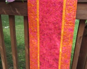 Bright orange and pink quilted table runner