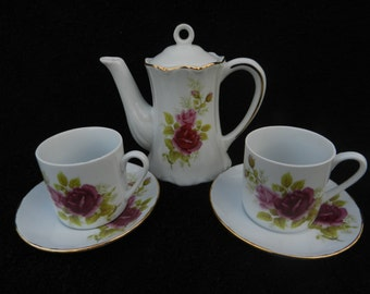 Child's Tea Set: Porcelain Hand Decorated.