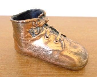 Single bronzed baby shoe