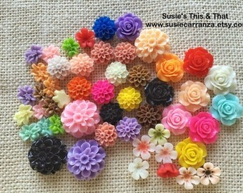 Fifty (50) Resin Flowers Cabochons.  Variety of colors, styles, and sizes. Flat backs.