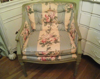 Vintage green upholstered chair with roses