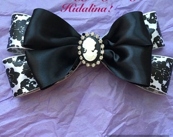 Black damask bow embelished adorn with a cameo button