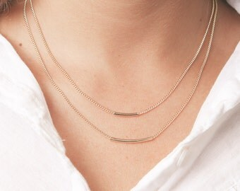 Gold curved bar necklaces set of two layered everyday necklaces delicate gold tube necklaces gold filled jewelry.