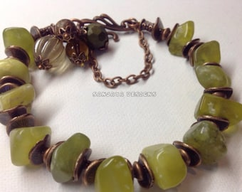Copper and Olive Jade Bracelet .