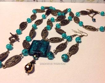 Stunning bronze necklace , bracelet and earring set .