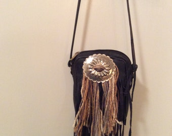 Navy repurposed fringe leather bag.