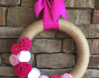 Fast shipping & turn over time. Valentine wreath with handcrafted felt flowers, and rosettes.