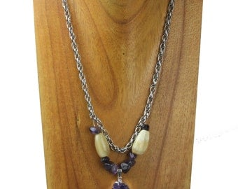 Horn necklace with amethyst charm, and amethyst scales. NS-109