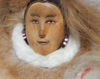 Vintage Inuit Eskimo native Doll with Traditional Fur Clothing, Handmade. Wood carved face, beads. Very collectible