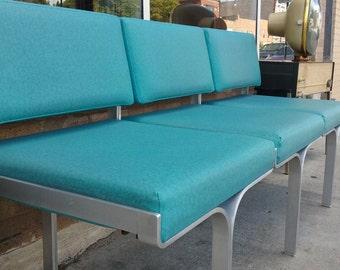 Erwine and Estelle Laverne Aluminum and Turquoise Vinyl Three Seat Sofa