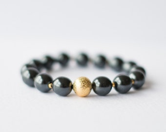 Black Pearl Bracelet with gold bead and spacers