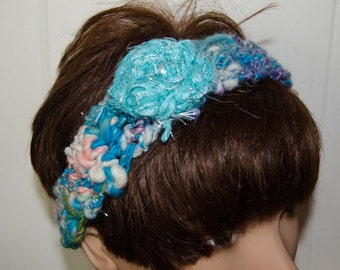 "Turquiose and Pink Head Band with  Fabric Flower  -Crochet Hair Wrap out of Hand Spun Art Yarn Measures 19"" but Adjustable"