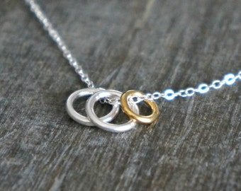 Three Eternity Circles on a Sterling Silver Chain // Two Small Silver Rings & One Tiny Gold Ring / Family of 3 • Dainty Personal Jewelry