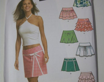 Simplicity 4705 Juniors  (Size 11/12-15/16) mini skirts with trim variations.  Easy-to-sew