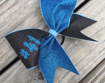 Glitter bow with your number.