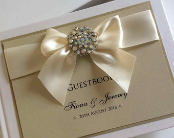 Luxury Wedding Guest Book with Crystal Button, Satin Ribbon Bow and Swarovski crystals. Available in many colours.