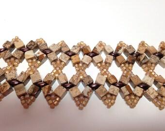Sand colored bead woven bracelet.