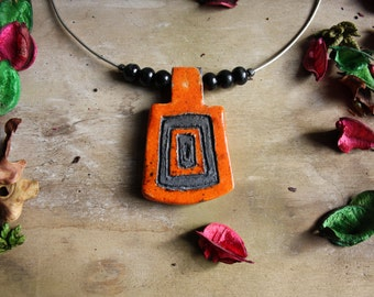 Necklace in silver and raku pottery