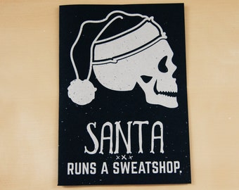 Santa Runs a Sweatshop -  hand screen printed card