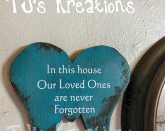 In this House our loved ones are never forgotten sign