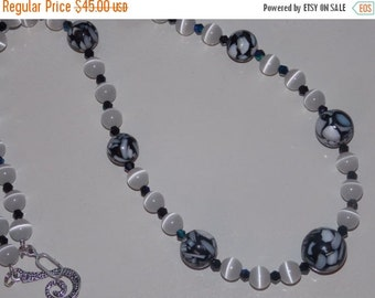 40%OFF Black Mother of Pearl Resin White Cats Eye and Black Crystal Necklace