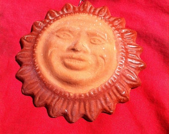 A Clay Sun Face Wall Decor