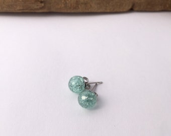 Delicate mint faceted eco-resin earrings with embedded flakes of silver coloured foil.