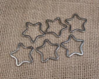 10 Silver-Tone Star Split Rings - Item 74075