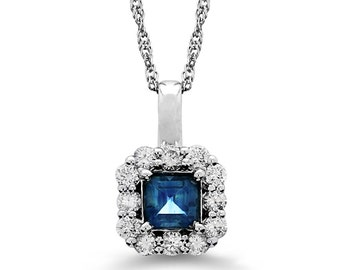 14k solid white gold diamond and sapphire pendant on a 14k white gold chain.