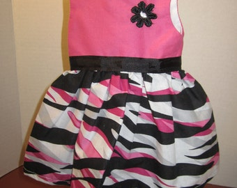Fifties inspired dress has hot pink top and zebra print skirt for AG dolls