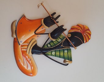 Musician man, wall hanging metal art.