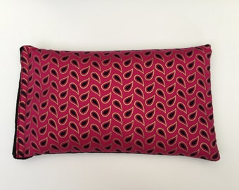 Metallic gold and pink cotton heat pack, filled with linseed, backed with black minky.