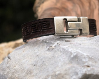 Hand tooled leather bracelet.