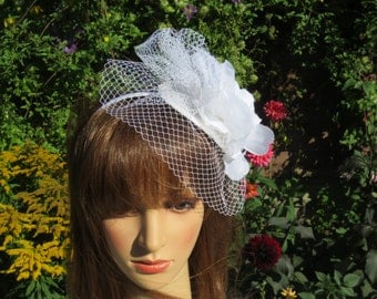 White veiling netting  with flower and feathers.Wedding,party.