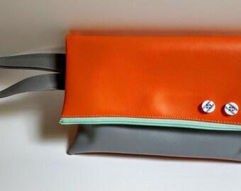 Grey and orange clutch, mint green zipper, striped buttons