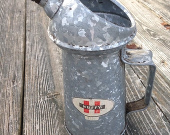 vintage huffy oil can