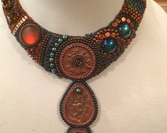 SOLD.  Raku beads in bead embroidery necklace.