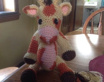 Gerald the Giraffe hand cocheted baby toy.