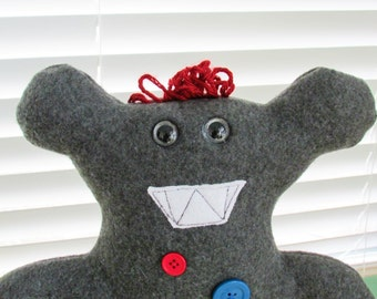 Grey fleece button monster