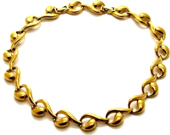 NINA RICCI, elegant gilded, formed of arabesques vintage metal collar