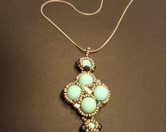 Pale turquoise beaded pendant necklace