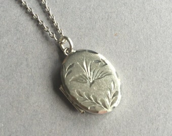 Vintage Little Sterling Silver Locket with Bird Engraved on the Front