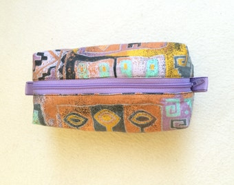 Colorful, edgy cosmetic bag, hand made from recycled fabric