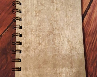 Faded gray 4x6 inch notebook with 50 blank white pages