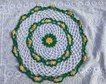 Hand crocheted yellow and green doily