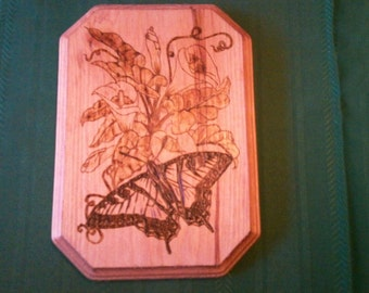 Butterfly and lilies wood burning