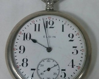 Vintage Elgin 7 jewel pocket watch wadsworth watch company running.
