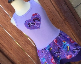 Custom made dress with licensed character fabric. Pony characters.